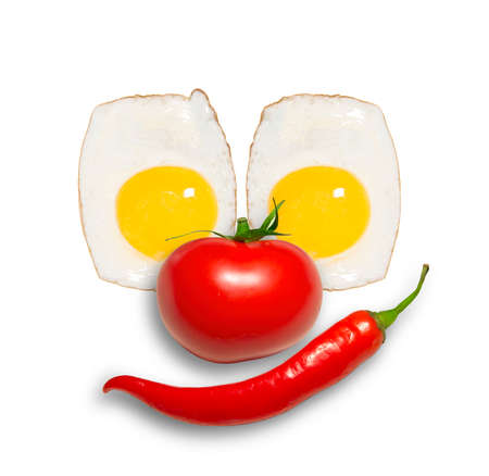 breakfast smiley face: funny eggs as a clowns face