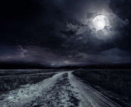 fool moon: country road at night with large moon