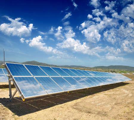 solar array: solar panels on the hilly terrain
