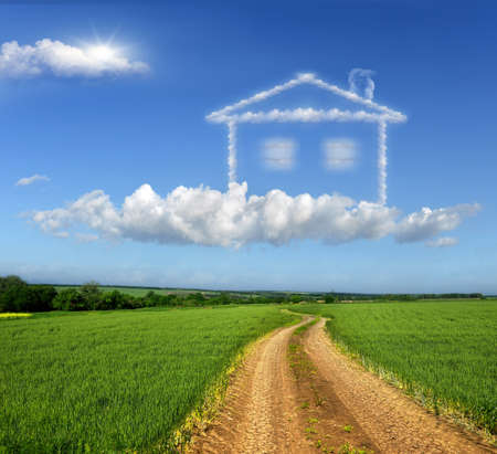 clouds: garden: Dirt road through the fields. Symbolizes the realization of the dream of home Stock Photo