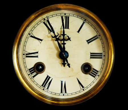 past midnight: vintage clock face, isolated on a black background. Late 19th century