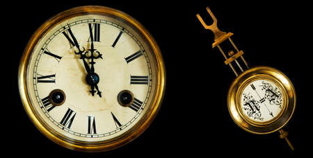 chiming: collection of old clocks and pendulum. The end of the 19th century. Isolated on a black background Stock Photo