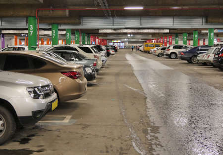 garage: Parking underground. A large number of vehicles Stock Photo