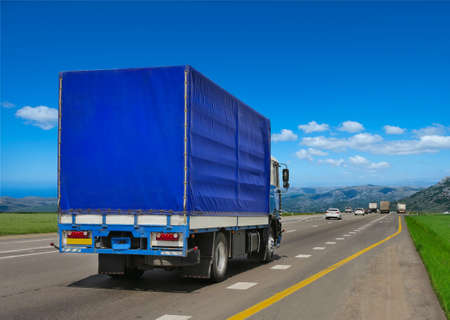 loads: Container on the big highway. transport loads Stock Photo