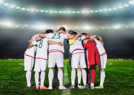 Football team players Hug the neck and for pray before playing football this image present about teamwork concept