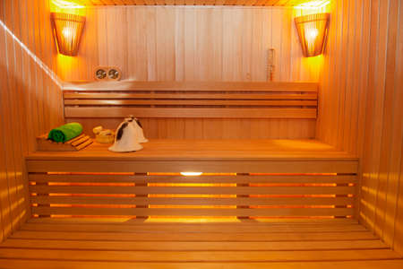 Sauna room with traditional sauna accessories