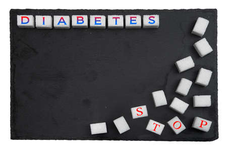 Treatment of diabetes. Conceptual poster prevention of diabetes in the background with sugar cubes Stock Photo