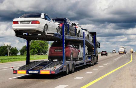 hauler: ROSTOV  DON. RUSSIA. M4-DON. June 16, 2016. The trailer transports cars on the highway M4 Don. June 16. Russia