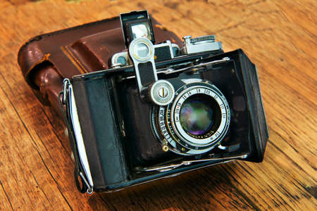 Old camera on a wooden background. Set of photographer Produced in the late 30-early 40s .