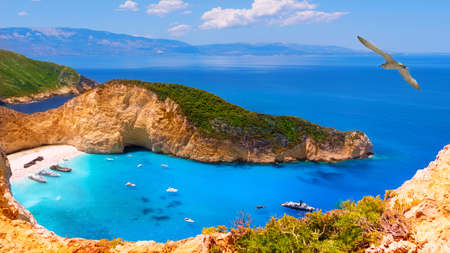Navagio bay and Ship Wreck beach in summer. The most famous natural landmark of Zakynthos, Navahio Bay. One of the most beautiful places in the World. View from a height of more than 500 meters. Albatross above the shipwreck bay Stock Photo