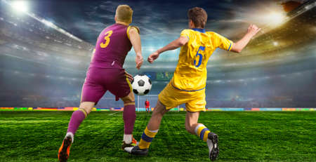 Soccer ball on the field of stadium with light . Footballer goes to the Takaku at the opponent's gate . Imagens
