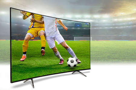 liquid crystal monitor on the background of the stadium broadcasts the soccer match