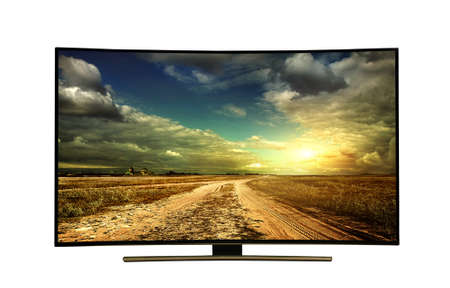monitor isolated on white.  The road is rural, unpaved in the steppes at sunset. Modern, elegant TV 4 K, with incredibly beautiful colors of the image. Stock Photo