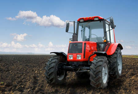 The Tractor - modern farm equipment in field 新聞圖片