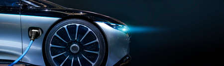 Luxury car electric car is charging. Close-up. EV Car. Electric car. Charging Station with the power cable plugged in.Technology car. A Future transport. Recharging. High technology . Transportation EV. Transport EV car. Innovation future. - Image