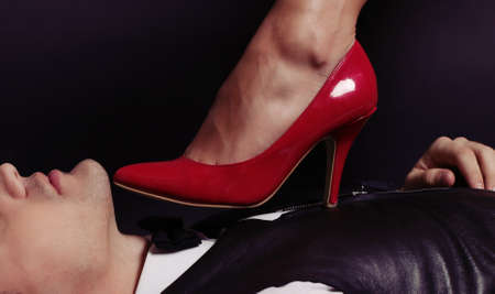 office love story.woman's legs in red shoes