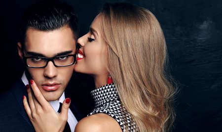 impassioned: fashion studio photo of beautiful sensual impassioned couple. office love story