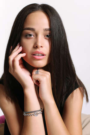glowing skin: fashion studio portrait of beautiful young woman with healthy glowing skin,with accessories