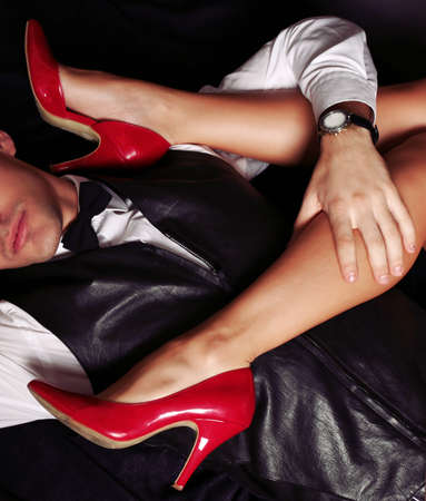 office shoes: fashion studio photo of beautiful sensual impassioned couple. office love story