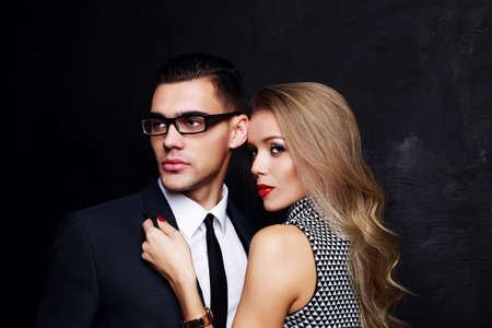 fashion studio photo of beautiful sensual impassioned couple. office love story