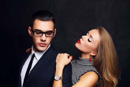 photo studio: fashion studio photo of beautiful sensual impassioned couple. office love story