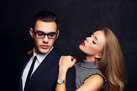 fashion studio photo of beautiful sensual impassioned couple. office love story
