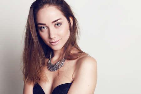 bijou: fashion studio photo of beautiful young woman with dark hair and natural makeup,with bijou