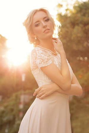 gorgeous: fashion outdoor photo of gorgeous bride with blond hair wears luxurious dress and accessories,posing in antic villa