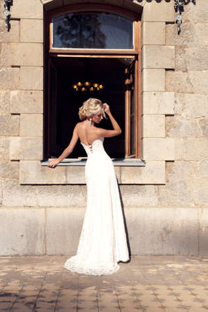 gorgeous girl: fashion outdoor photo of gorgeous bride with blond hair wears luxurious dress and accessories,posing in antic villa