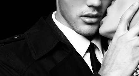 fashion black and white studio photo of beautiful sensual impassioned couple. office love story Foto de archivo