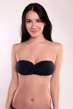beautiful body: fashion studio photo of beautiful woman with perfect body, with dark straight hair wears black bikini
