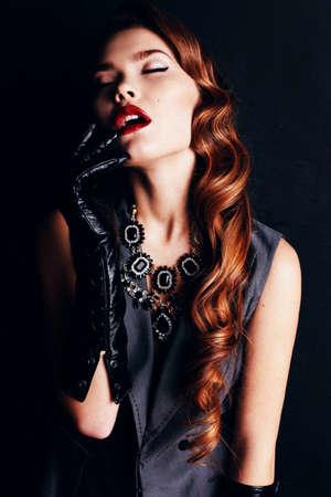fashion studio portrait of beautiful gorgeous woman with dark curly hair with bijou Stock Photo