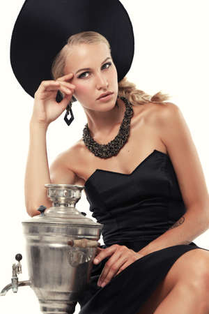russian hat: fashion studio photo of gorgeous woman with blond hair in russian national hat with samovar