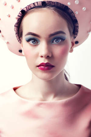 russian hat: fashion studio photo of gorgeous woman with dark hair and bright makeup in russian national hat Stock Photo