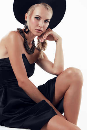 russian hat: fashion studio photo of gorgeous woman with blond hair in russian national hat