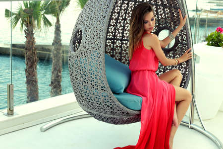 fashion summer outdoor photo of gorgeous woman with dark hair in elegant dress