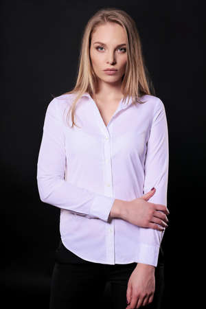 businesslike: fashion studio photo of businesslike woman with blond straight hair in elegant office outfit