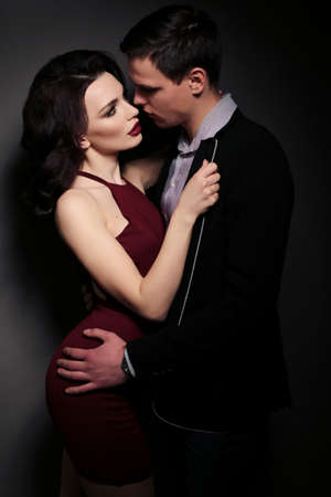 impassioned: Valentines day. fashion studio photo of lovely impassioned couple in elegant outfit
