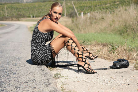 chic: fashion photo of beautiful woman with blond hair in elegant clothes posing outdoor