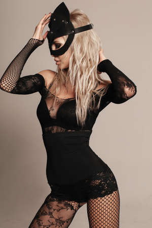 fashion photo of sexy woman with blond hair in sexy clothes with bunny mask on face