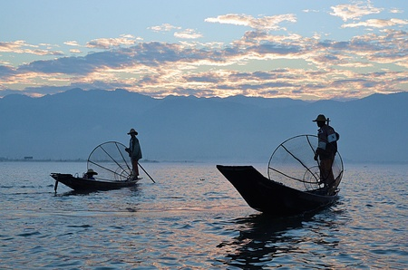 inle: Silhouette two fisherman on sunrise at Inle Lake, Myanmar