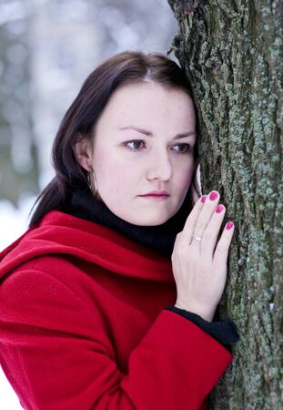 Sad young beautiful girl in the red coat Stock Photo - 9371933