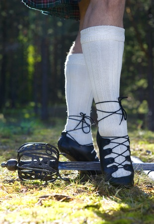 scot: Mans legs in shoes for scottish dancing Stock Photo