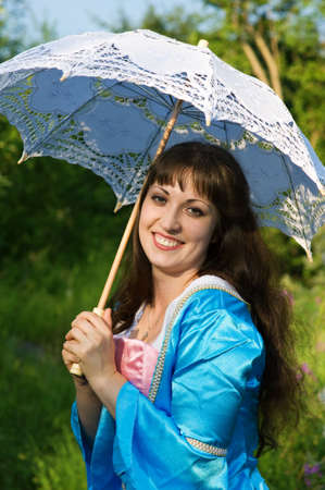 Young beautiful woman with white umbrella photo
