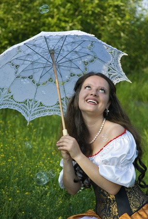 Laughing woman with umbrella photo