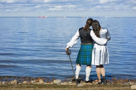 scot: Woman and man looking at the sea Stock Photo