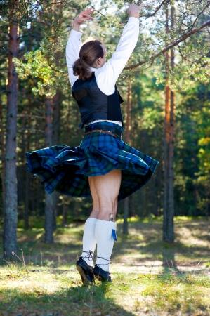 scottish: Dancing man in scottish costume outdoor Stock Photo