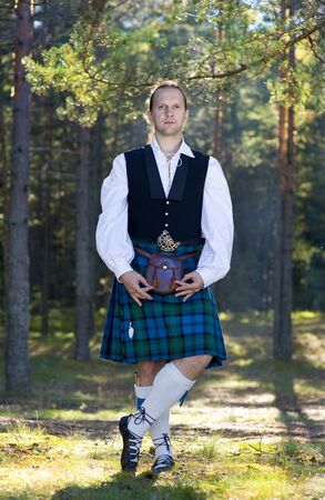 scot: Handsome man in scottish costume in the forest