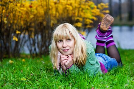 gaiters: Blond woman in purple gaiters lying on the grass