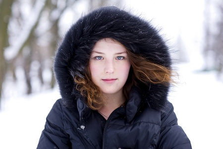 Young girl in the hood with fur photo